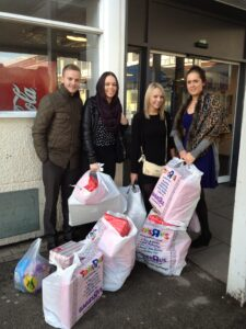 Taxi Cab Insurance Team deliver Christmas presents to local children's hospital