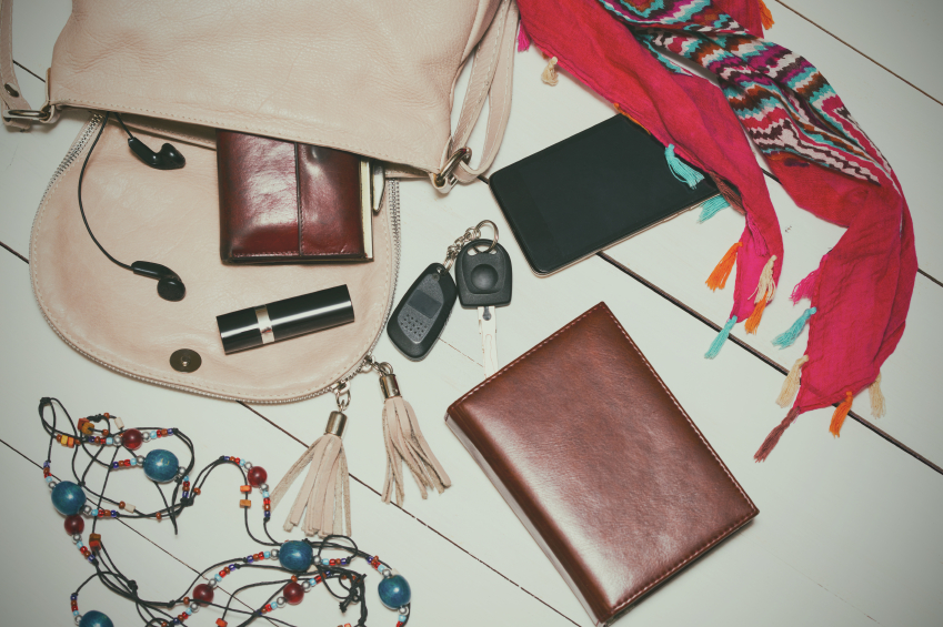 the contents of the female handbag - wallet, keys, phone, lipstick, perfume. vintage