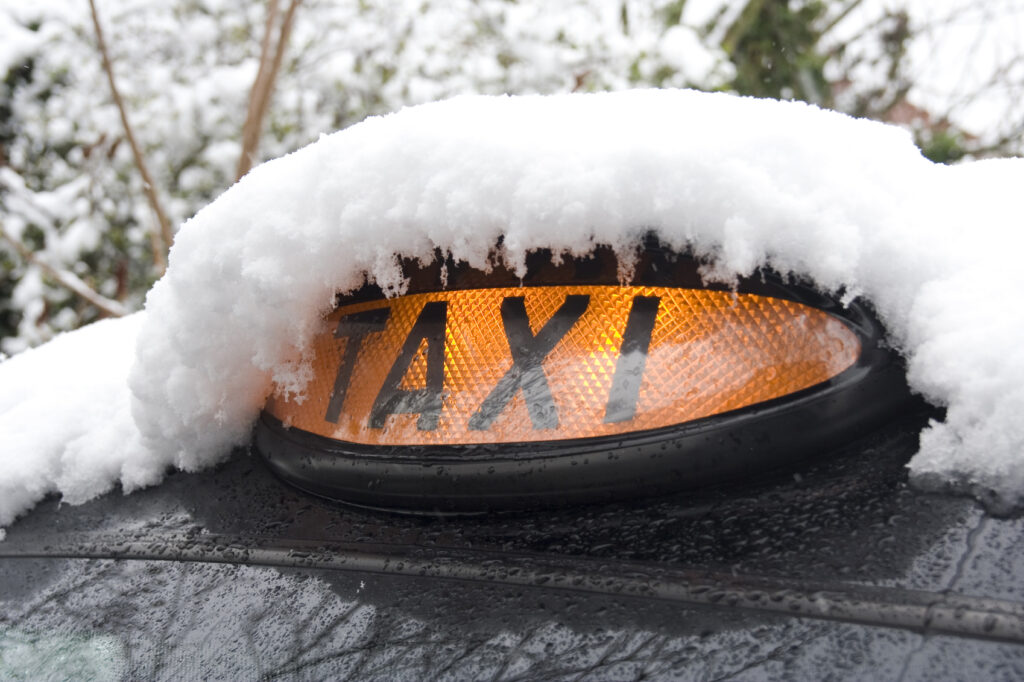 taxi covered in snow iStock_000005836692_Medium