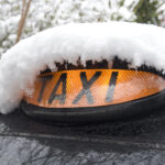 Taxi Covered in Snow